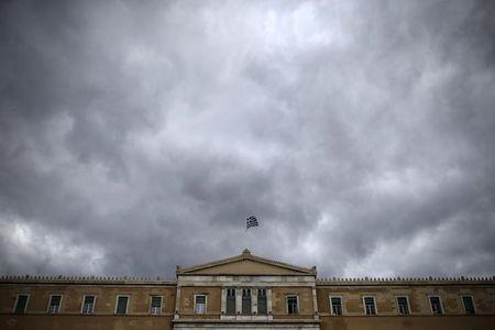 A Greek national flag flutters atop the parliament building in Athens, Greece, October 30, 2015. REUTERS/Alkis Konstantinidis