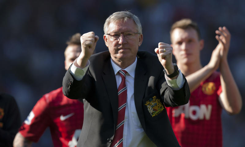 Manchester United manager Alex Ferguson gestures to supporters after the English Premier League soccer match away against  West Bromwich Albion, his last as manager of Manchester United, at The Hawthorns Stadium, West Bromwich, England, Sunday May. 19, 2013. (AP Photo/Jon Super)