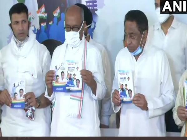 Congress leaders jeetu Patwari (Left), Digvijaya Singh (Centre) and Kamal Nath releasing party's manifesto for MP By-polls. (Photo/ANI)