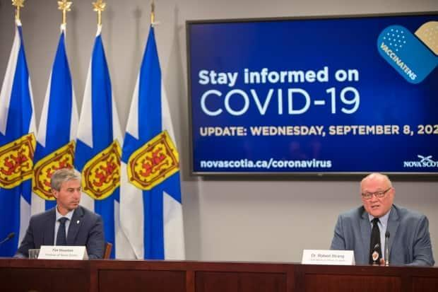 Premier Tim Houston, left, and Chief Medical Officer of Health Dr. Robert Strang are shown at the Wednesday, Sept. 8, 2021, COVID-19 briefing. The pair announced Nova Scotia's proof of vaccination system at this news conference. (Communications Nova Scotia - image credit)
