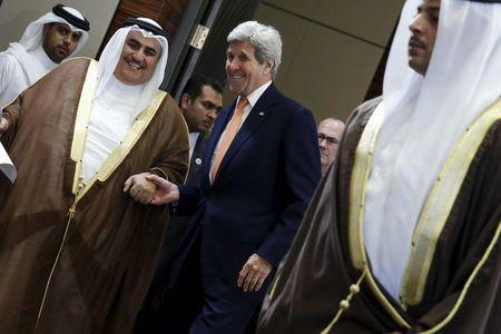 Bahrain's Foreign Minister Sheikh Khalid bin Ahmed al-Khalifa (L) and U.S. Secretary of State John Kerry (3rd R) arrive to speak to reporters ahead of the Gulf Cooperation Council (GCC) Ministerial meeting in Manama, Bahrain April 7, 2016. REUTERS/Jonathan Ernst