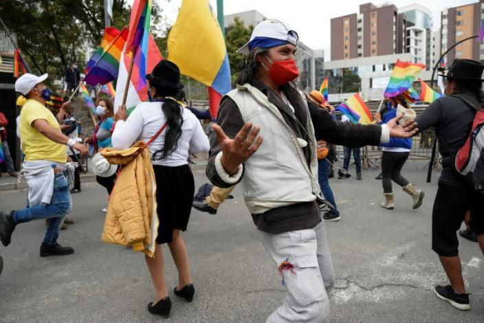 Members of indigenous communities and supporters of Ecuador's presidential candidate Yaku Perez gather outside the Electoral National Council (CNE) in Quito