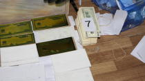 In this photo provided by Bulgaria's Interior Ministry on Tuesday, March 16, 2021, items used to print counterfeit money at a printing office in a university, in Sofia. Bulgarian authorities say they have seized high-quality forged banknotes produced at a printing office in a university in the Bulgarian capital. In a joint operation with U.S. Secret Service, Bulgarian police detained two people and seized a printing machine and equipment for printing money, along with large amounts of counterfeit U.S. dollar and euro notes. (Bulgarian Interior Ministry via AP)