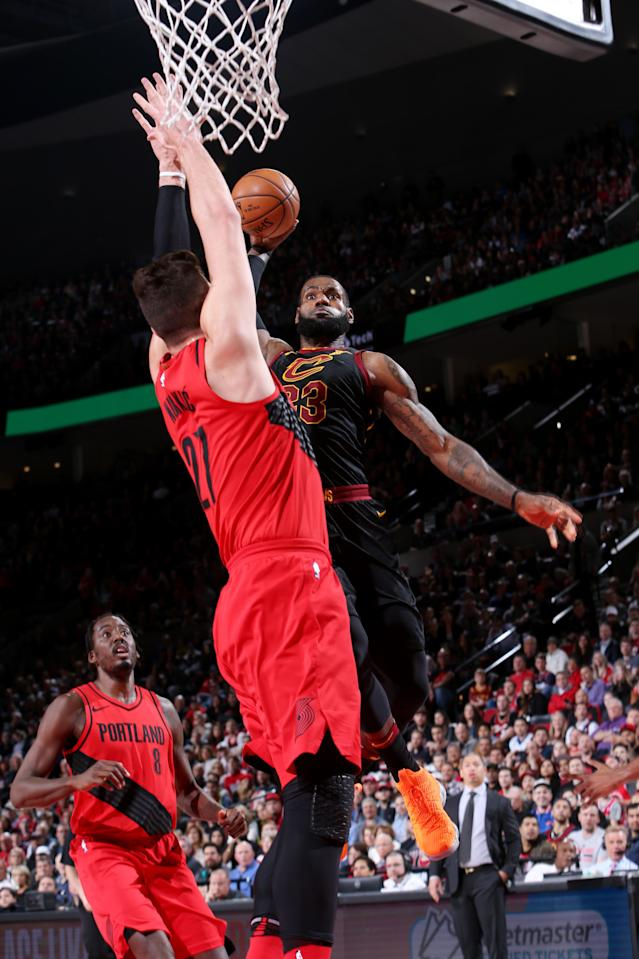 LeBron James dunks the ball on Jusuf Nurkic. Man, does he ever.)Sam Forencich/NBAE/Getty Images)