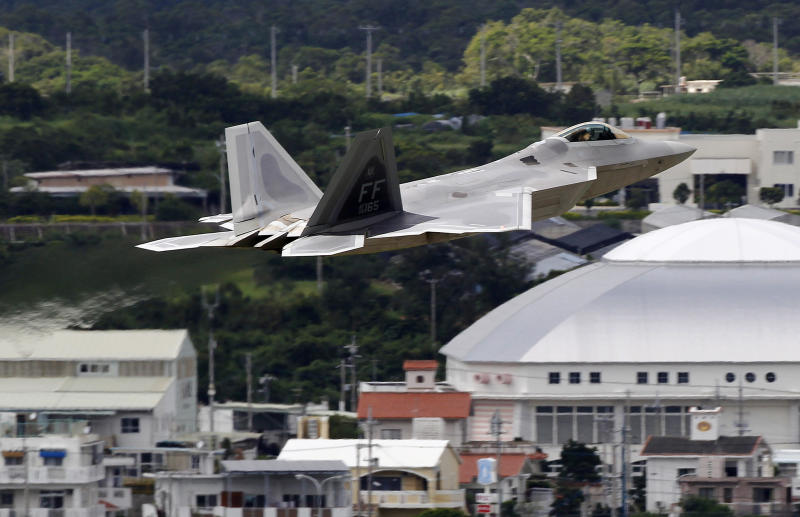 FILE - In this Aug. 14, 2012 file photo, a U.S. Air Force F-22 Raptor stealth fighter takes off from Kadena Air Base on the southern island of Okinawa in Japan. China is trying to strengthen its claim on tiny, uninhabited, Japanese-controlled islands, Senkaku in Japanese and Diaoyu in Chinese, by raising questions about the much larger Okinawa chain that is home to more than a million Japanese along with major U.S. military installations. The tactic, however, appears to have done little but harden Tokyo's stance. (AP Photo/Greg Baker, File)