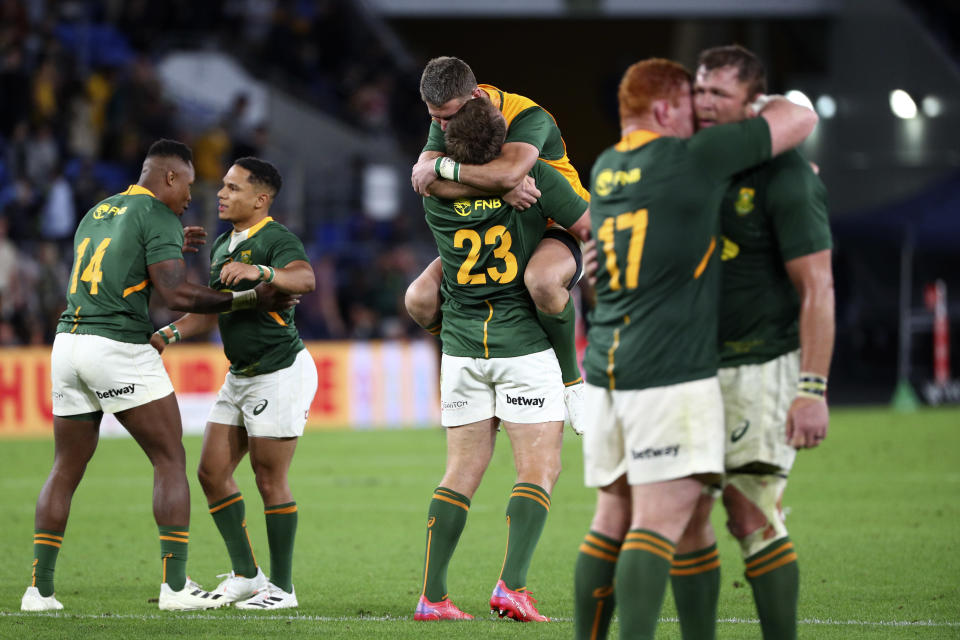 South African players celebrate their win over New Zealand during their Rugby Championship test match on the Gold Coast, Australia, Saturday, Oct. 2, 2021. (AP Photo/Tertius Pickard)