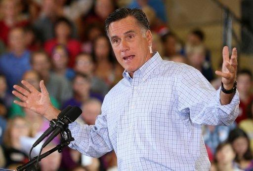 """Republican presidential candidate Mitt Romney speaks during campaign event at the Jefferson County Fairgrounds in Golden, Colorado. President Barack Obama slammed Romney's """"fairy dust"""" tax cuts, claiming his millionaire Republican foe would swell his own wealth while sticking the middle class with the bill"""