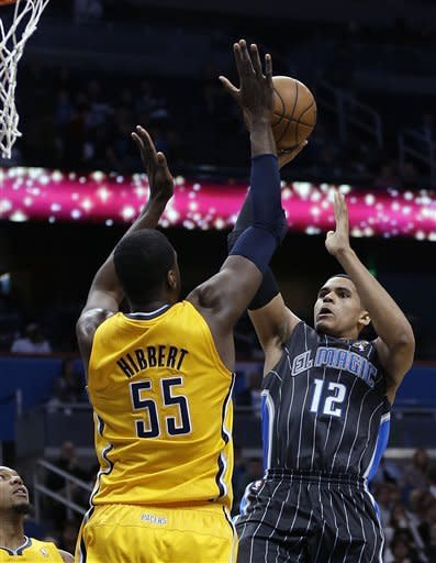 Orlando Magic's Tobias Harris (12) takes a shot over Indiana Pacers' Roy Hibbert (55) during the first half of an NBA basketball game, Friday, March 8, 2013, in Orlando, Fla. (AP Photo/John Raoux)