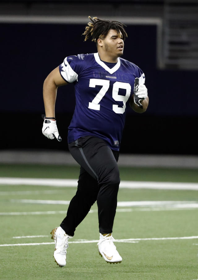 f42e0d094c7 Dallas Cowboys rookie defensive tackle Trysten Hill jogs across the field  at the end of the