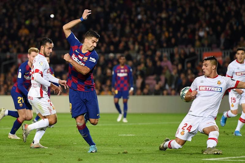 Luis Suarez's back-heel goal against Mallorca begs to be watched again and again. (Photo by Alex Caparros/Getty Images)