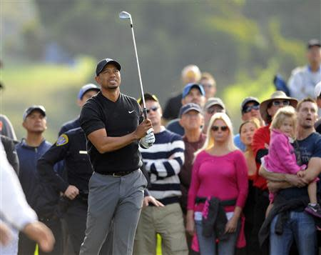 Jan 25, 2014; La Jolla, CA, USA; Tiger Woods watches after hitting his ball out of the rough on the twelfth hole during the third round of the Farmers Insurance Open golf tournament at Torrey Pines Municipal Golf Course - South Co. Mandatory Credit: Christopher Hanewinckel-USA TODAY Sports
