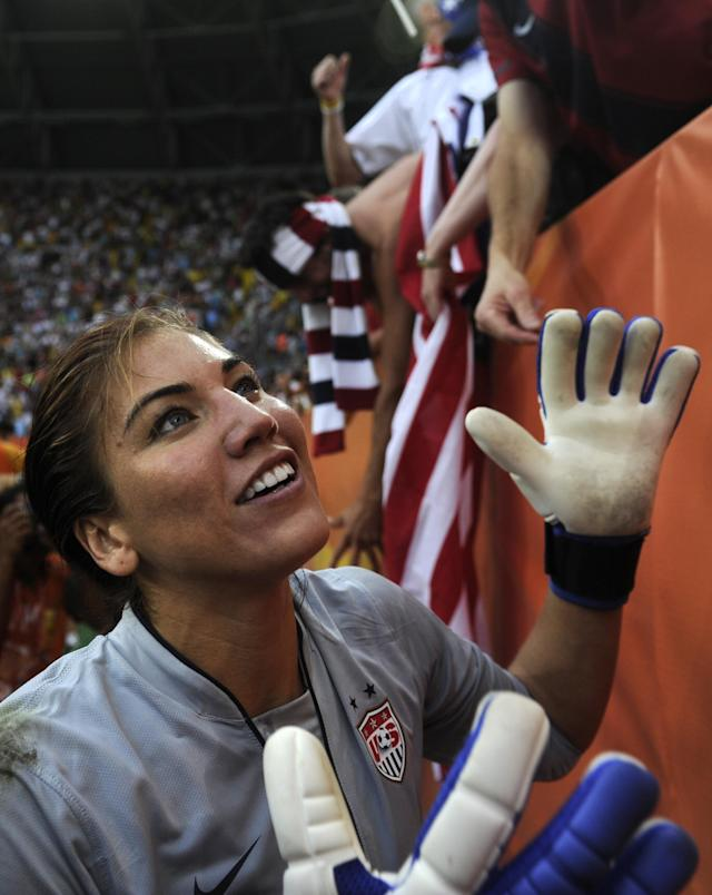 USA's goalkeeper Hope Solo celebrates with supporters after the quarter-final match of the FIFA women's football World Cup Brazil vs USA on July 10, 2011 in Dresden, eastern Germany. The USA won the match after a penalty shoot-out. AFP PHOTO / ODD ANDERSEN (Photo credit should read ODD ANDERSEN/AFP/Getty Images)