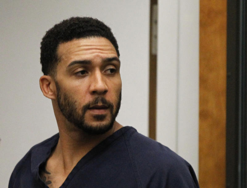 The Latest: Ex-NFL player will face new rape trial
