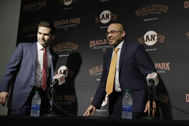 San Francisco Giants general manager Scott Harris, left, and president of baseball operations Farhan Zaidi take their seats at the start of a news conference at Oracle Park, Monday, Nov. 11, 2019, in San Francisco. The Giants hired Harris from the Chicago Cubs to become general manager, filling a void of more than a year after the club had gone without a GM during Zaidi's first season in the position.(AP Photo/Eric Risberg)