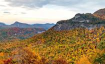 """For just a $2 parking fee, hikers on this two-mile-plus loop are rewarded with majestic views of the <a href=""""https://www.cntraveler.com/stories/2016-05-12/blue-ridge-parkway?mbid=synd_yahoo_rss"""" rel=""""nofollow noopener"""" target=""""_blank"""" data-ylk=""""slk:Blue Ridge Mountains"""" class=""""link rapid-noclick-resp"""">Blue Ridge Mountains</a>. On clear days, you'll see South Carolina, Tennessee, and Georgia; on cloudier ones, the mountain fog guarantees a spooky feel. Look for the peregrine falcons that nest in the mountain's cliffs."""