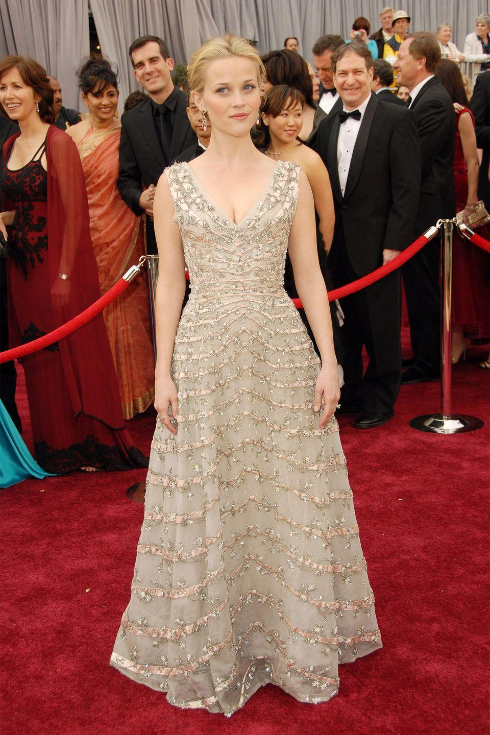 <p>In a 1950's Christian Dior dress, the <em>Walk the Line</em> star collected her Oscar for Best Actress. </p>