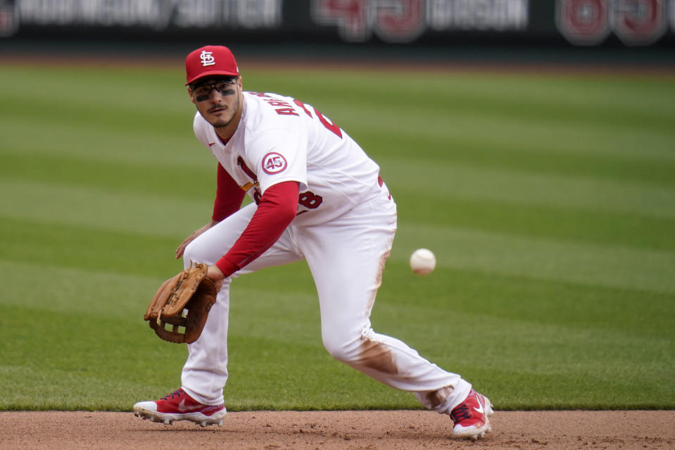 St. Louis Cardinals third baseman Nolan Arenado handles a grounder by New York Mets' Pete Alonso during the fifth inning of a baseball game Thursday, May 6, 2021, in St. Louis. Alonso reached base on a throwing error by Arenado on the play. (AP Photo/Jeff Roberson)