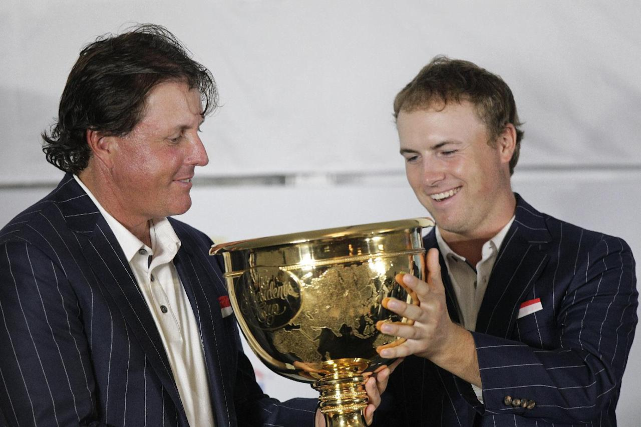 United States team player Jordan Spieth, right, and teammate Phil Mickelson hold the Presidents Cup after the U.S. won the Presidents Cup golf tournament at Muirfield Village Golf Club Sunday, Oct. 6, 2013, in Dublin, Ohio. (AP Photo/Jay LaPrete)