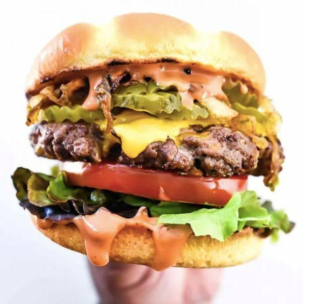 "<strong>Get the <a href=""https://www.foodiecrush.com/bacon-double-cheddar-cheeseburger-with-caramelized-onions/"" target=""_blank"" rel=""noopener noreferrer"">Bacon Double Cheddar Cheeseburger</a> recipe from Foodie Crush</strong>"