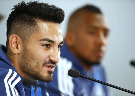 German national soccer players Jerome Boateng and Ilkay Guendogan (L) attend a news conference in Frankfurt, Germany, October 6, 2015. Germany will play a Euro 2016 qualification match against Ireland on Thursday.  REUTERS/Ralph Orlowski