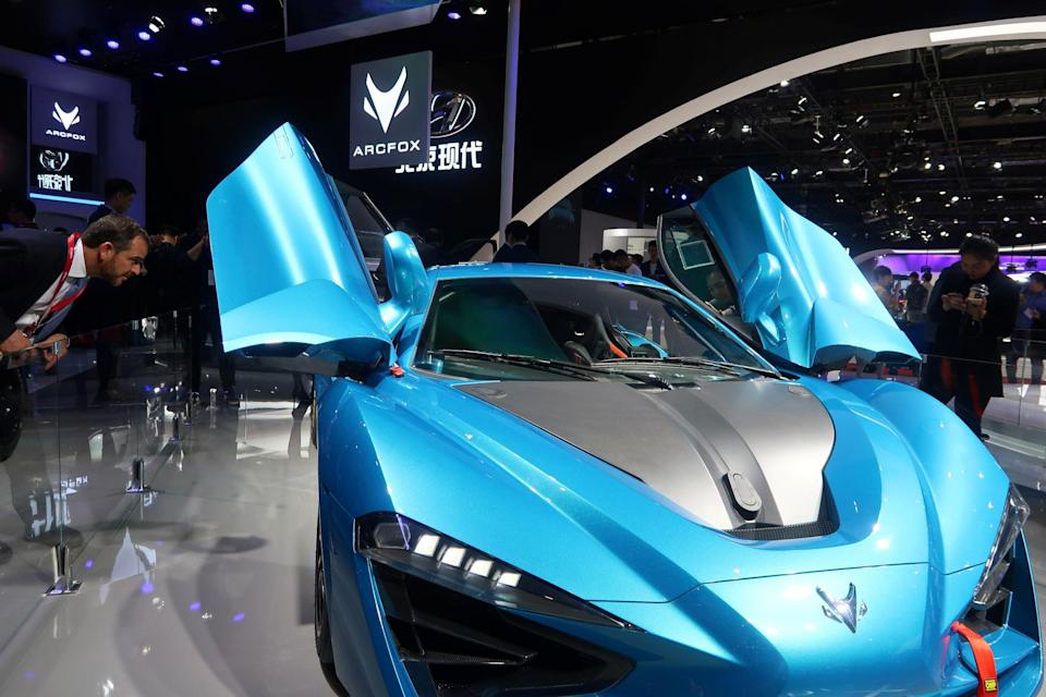 A man looks at an Arcfox GT Race Edition at the Shanghai auto show in April 2019. Photo: Reuters