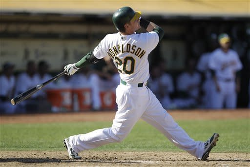 Oakland Athletics' Josh Donaldson watches his two-run home run off Seattle Mariners' Tom Wilhelmsen in the ninth inning of a baseball game Saturday, Sept. 29, 2012, in Oakland, Calif. The Athletics won 7-4 in 10 innings. (AP Photo/Ben Margot)