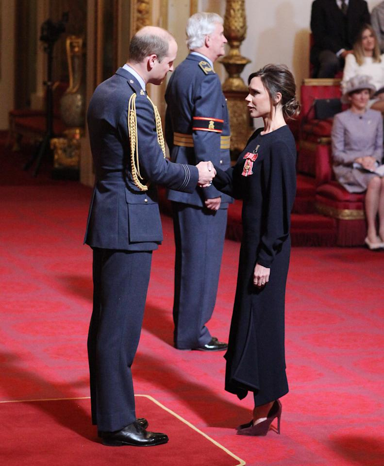<p>The Beckham clan are familiar faces at Buckingham Palace, as Victoria received an OBE for her services to the fashion industry. Unsurprisingly, the designer dressed in one of her own all-black ensembles for the occasion. <em>[Photo: PA]</em> </p>