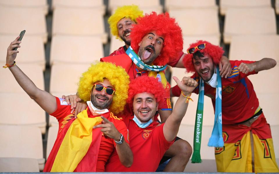 Spain fans pose for a photo in the stands - AP