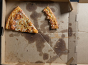 """<p>You might want to rethink that late-night order for pizza… for a lot of reasons. <a href=""""http://www.ncbi.nlm.nih.gov/pmc/articles/PMC4330685/"""" rel=""""nofollow noopener"""" target=""""_blank"""" data-ylk=""""slk:That cheesy topping might give you nightmares"""" class=""""link rapid-noclick-resp"""">That cheesy topping might give you nightmares</a>, according to a recent study, and the acidic tomato sauce can lead to tummy aches and 2 a.m. trips to the bathroom. Plus, pizza is really more than a bedtime snack; eating a second dinner adds a lot of extra calories that you probably don't need.</p>"""