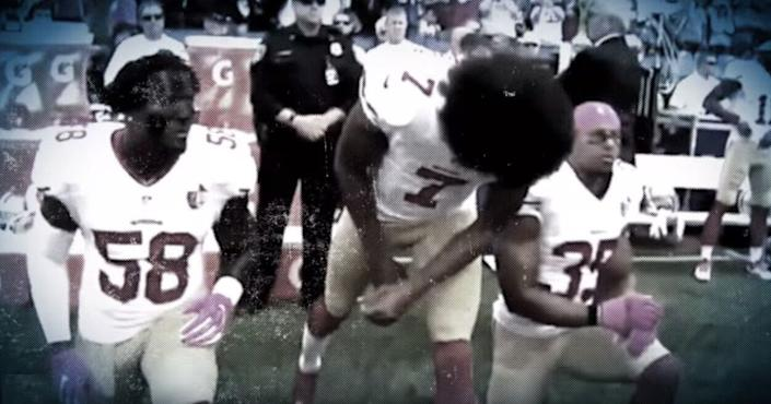 Colin Kaepernick and other San Francisco 49ers players kneeling in protest during the national anthem. (Photo: YouTube)