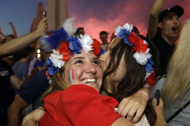 <p>French soccer fans hug each other on the final whistle as they watch a live broadcast of the semifinal match between France and Belgium at the 2018 soccer World Cup, in Marseille, southern France, Tuesday July 10, 2018. France has advanced to the World Cup final for the first time since 2006 with a 1-0 win over Belgium. (AP Photo/Claude Paris) </p>