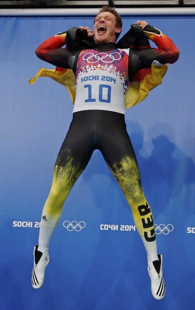 Germany's Felix Loch celebrates after winning the men's singles luge event at the 2014 Sochi Winter Olympics, at the Sanki Sliding Center February 9, 2014. REUTERS/Fabrizio Bensch (RUSSIA - Tags: SPORT LUGE OLYMPICS TPX IMAGES OF THE DAY)
