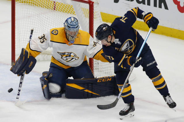 Buffalo Sabres forward Evan Rodrigues (71) passes the puck in front of Nashville Predators goalie Pekka Rinne (35) during the first period of an NHL hockey game Tuesday, April 2, 2019, in Buffalo, N.Y. (AP Photo/Jeffrey T. Barnes)