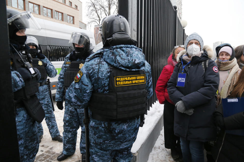 Russian Federal Bailiffs service officers stand guard at the Babushkinsky district court prior to the start of the trial against Russian opposition leader Alexey Navalny in Moscow, Russia, Saturday, Feb. 20, 2021. Two trials against Navalny will be held: Moscow City Court will consider an appeal against his imprisonment in the embezzlement case and Babushkinsky District Court will announce a verdict in the defamation case. (AP Photo/Alexander Zemlianichenko)