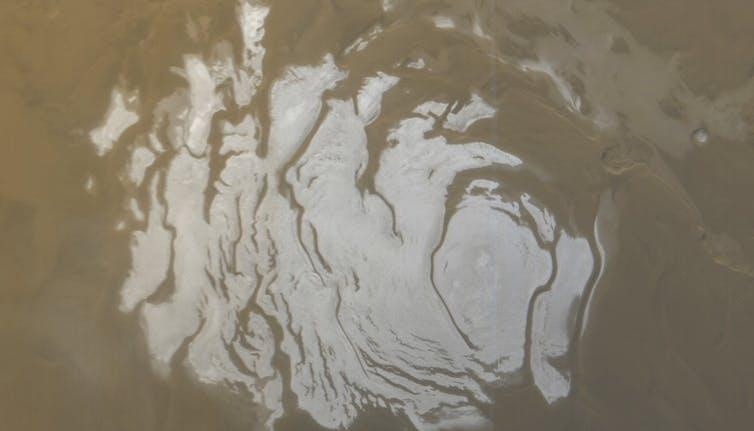 The white ice cap at the south pole of Mars, seen from space.