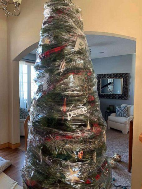 PHOTO: Renae Krivitz shared photos of her plastic-wrapped Christmas tree on Facebook with the text, 'My new time saving Christmas tree invention. No more decorating/un-decorating. Wrap it and store it!' (Courtesy Renae Krivitz)