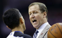 Portland Trail Blazers coach Terry Stotts, right, talks with official Zach Zarba, left, during a timeout in the second quarter of an NBA basketball game against the Houston Rockets, Sunday, March 9, 2014, in Houston. (AP Photo/David J. Phillip)