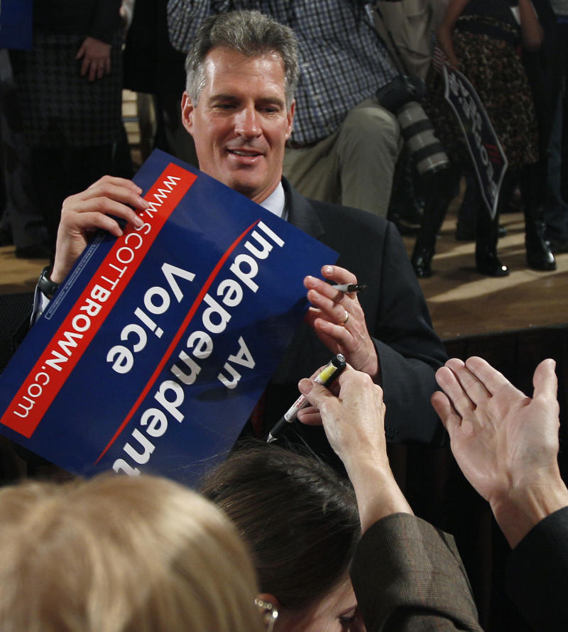 FILE - In this Jan. 19, 2012, file photo U.S. Sen. Scott Brown, R-Mass., shakes hands and signs autographs for supporters during his re-election campaign kick-off in Worcester, Mass. Republicans' clear shot at winning control of the Senate is attracting tens of millions of dollars from GOP-allied outside groups eager to spend on a surer bet than the White House race. Control of the U.S. Senate will hinge on some tight races, including the Massachusetts race, seen by Democrats as one of their best chances of unseating one of the newest Republican senators, Brown.  (AP Photo/Charles Krupa, File)