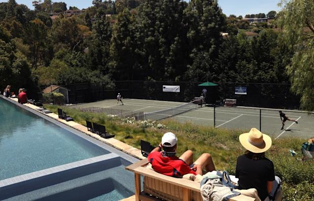 """A few friends and family watch a match between Brandon Holt, left, and Marcos Giron at the Homecourt Advantage tournament in Rolling Hills on Sunday. <span class=""""copyright"""">(Genaro Molina / Los Angeles Times)</span>"""