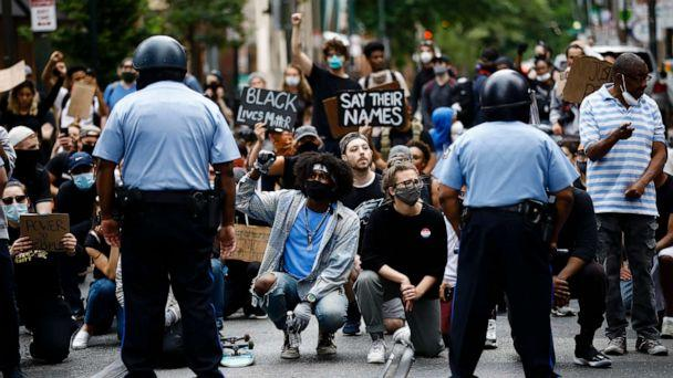 PHOTO: Demonstrators take a knee, June 2, 2020, in Philadelphia, during a protest over the death of George Floyd. (Matt Rourke/AP)
