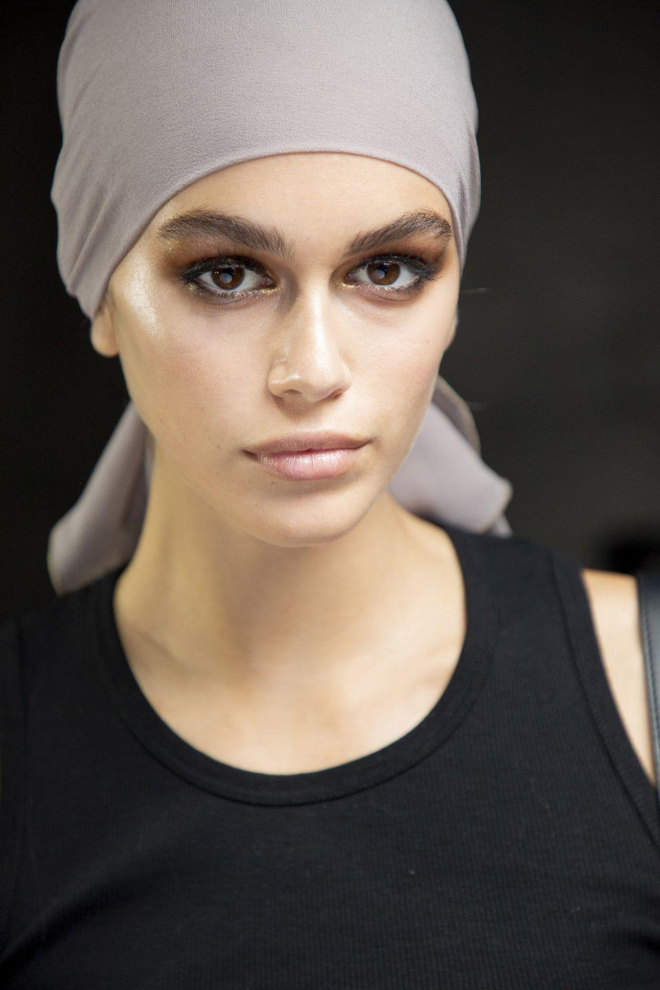 """<p>Makeup artist Diane Kendal created a golden smoky eye for the '70s-inspired Tom Ford show. Her team of makeup artists meticulously blended the eyeshadow and liner until the look was hazy and glam.</p><p><strong>Tom Ford</strong> Eye Color Quad in Golden Mink, $88, <a rel=""""nofollow noopener"""" href=""""https://www.sephora.com/product/eye-color-quad-P422568?skuId=1987718"""" target=""""_blank"""" data-ylk=""""slk:sephora.com"""" class=""""link rapid-noclick-resp"""">sephora.com</a>.</p><p><a rel=""""nofollow noopener"""" href=""""https://www.sephora.com/product/eye-color-quad-P422568?skuId=1987718"""" target=""""_blank"""" data-ylk=""""slk:SHOP"""" class=""""link rapid-noclick-resp"""">SHOP</a><br></p>"""