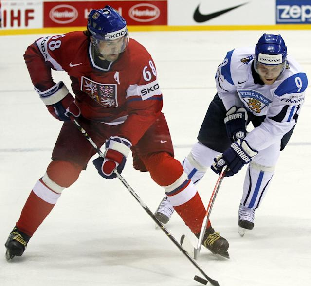 FILE - In this May 4, 2011, file photo, Czech's Jaromir Jagr, left, challenges for the puck with Finland's Mikko Koivu, from left, during the preliminary round match at the World Hockey Championships in Bratislava, Slovakia. Jagr leads a lively Czech team into his fifth Olympics. (AP Photo/Ronald Zak, File)
