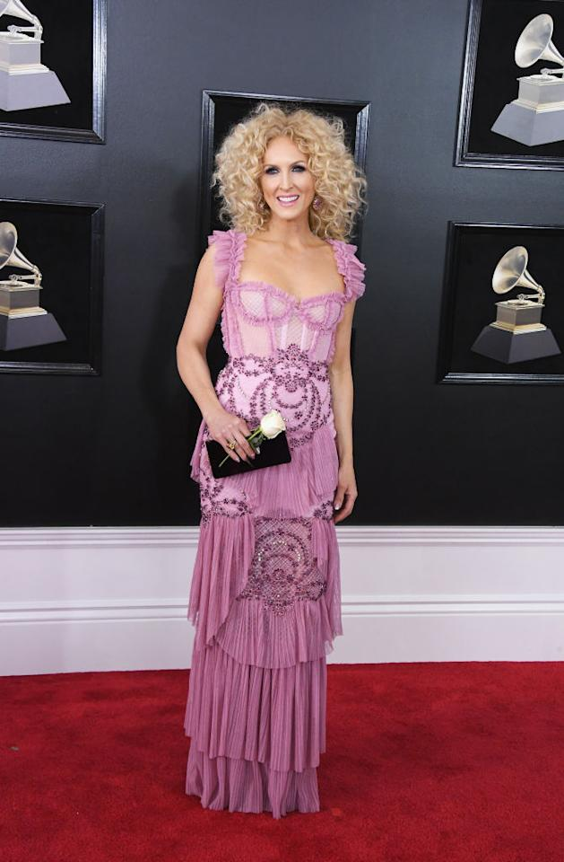 <p>Kimberly Schlapman of Little Big Town, whose group is up for Best Country Album at the 60th Annual Grammy Awards, glowed in a romantic lilac gown. She carried a white rose to show her support for gender equality. (Photo: John Shearer/Getty Images) </p>