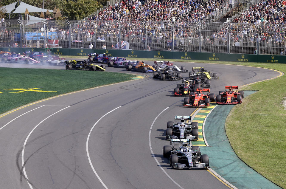 In this March 17, 2019, file photo, Mercedes driver Valtteri Bottas of Finland, bottom, leads his teammate Lewis Hamilton of Britain and the rest of the pack during the start of the Australian Formula 1 Grand Prix in Melbourne, Australia. The start of the 2021 Formula One season has been delayed after the Australian Grand Prix was postponed because of the coronavirus pandemic. The Australian race in Melbourne has been rescheduled from March 21 to November 21. (AP Photo/Rick Rycroft, File)