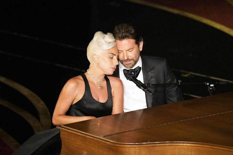"""<p>When Lady Gaga and Bradley Cooper's 2019 <a href=""""https://www.goodhousekeeping.com/life/entertainment/a26412507/a-star-is-born-original-remake-movie-plot-comparison/"""" rel=""""nofollow noopener"""" target=""""_blank"""" data-ylk=""""slk:version of"""" class=""""link rapid-noclick-resp"""">version of </a><em><a href=""""https://www.goodhousekeeping.com/life/entertainment/a26412507/a-star-is-born-original-remake-movie-plot-comparison/"""" rel=""""nofollow noopener"""" target=""""_blank"""" data-ylk=""""slk:A Star Is Born"""" class=""""link rapid-noclick-resp"""">A Star Is Born</a></em> hit theaters in October 2018, fans immediately began """"shipping"""" them as a couple — despite the fact that Gaga was engaged and Bradley was in a long-term relationship. The pair went on to give a <em>very</em> passionate performance of <a href=""""https://www.goodhousekeeping.com/life/entertainment/a26411571/a-star-is-born-lady-gaga-shallow-lyrics-meaning/"""" rel=""""nofollow noopener"""" target=""""_blank"""" data-ylk=""""slk:their original song for the film, &quot;Shallow,&quot;"""" class=""""link rapid-noclick-resp"""">their original song for the film, """"Shallow,""""</a> at the 2019 Oscars, which only added fuel to the romance rumors' fire. (Both of the stars' relationships have ended since then, but they still have not dated each other.) </p>"""