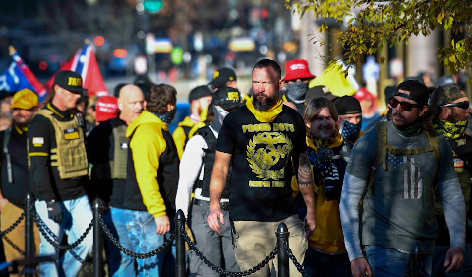 Members of the Proud Boys march near the White House and Black Lives Matter Plaza on Dec 12, 2020.