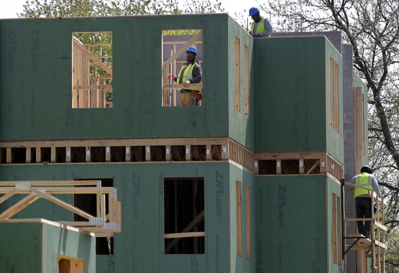 In this  Wednesday, April 24, 2013, photo, workers are seen at the construction site of a new housing complex, in Trenton, N.J.  The Commerce Department reports on new-home sales for April on Thursday, May 23, 2013. (AP Photo/Mel Evans)