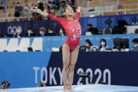 Tang Xijing, of China, performs on the balance beam during the artistic gymnastics women's apparatus final at the 2020 Summer Olympics, Tuesday, Aug. 3, 2021, in Tokyo, Japan. (AP Photo/Ashley Landis)