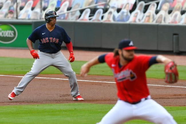 Braves face Reds in playoffs; Red Sox win Roenicke finale
