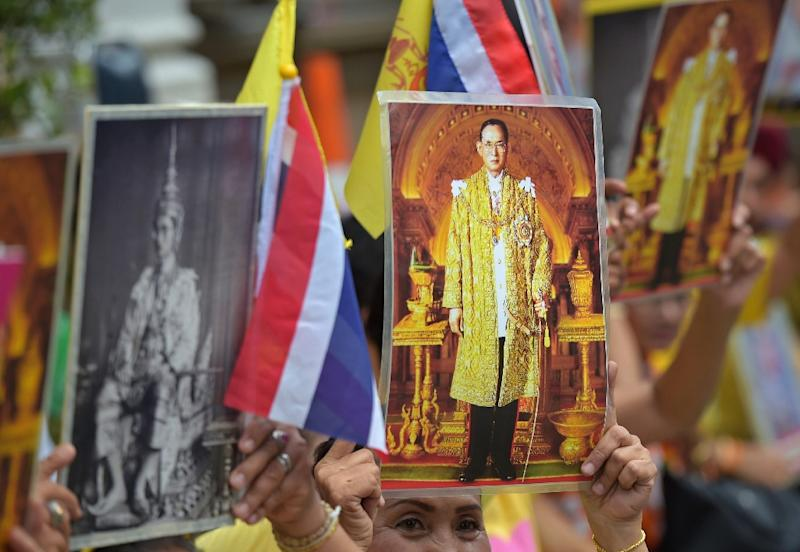 Thailand's King Bhumibol Adulyadej is protected by one of the world's toughest royal defamation laws and prosecutions under it have skyrocketed since a military junta took power in May 2014 (AFP Photo/Pornchai Kittiwongsakul)